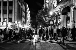 Crowd crossing a street in the night