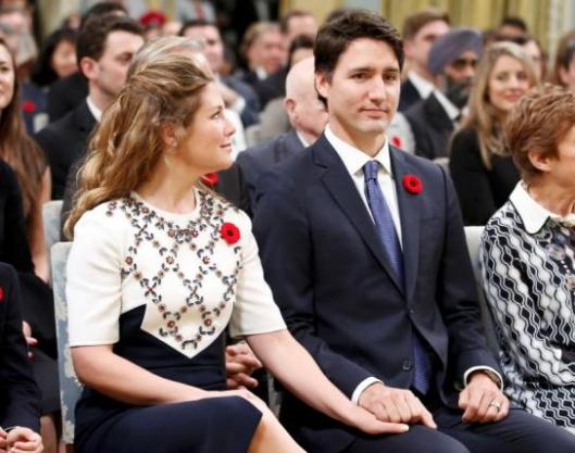 Justin Trudeau and his wife Sophie Gregoire hold hands before he is sworn-in as Canada's 23rd prime minister during a ceremony at Rideau Hall in Ottawa November 4, 2015.  REUTERS/Chris Wattie