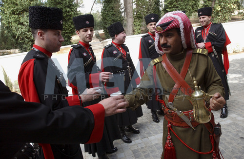A_soldier_from_the_Bedouin_Royal_Guard_serving_coffee_to_Circassian_soldiers.jpg