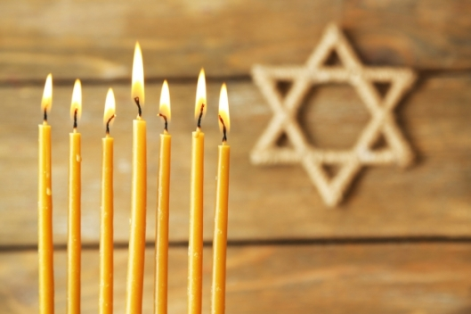bigstock-hanukkah-candle-on-wooden-back-74198233.jpg